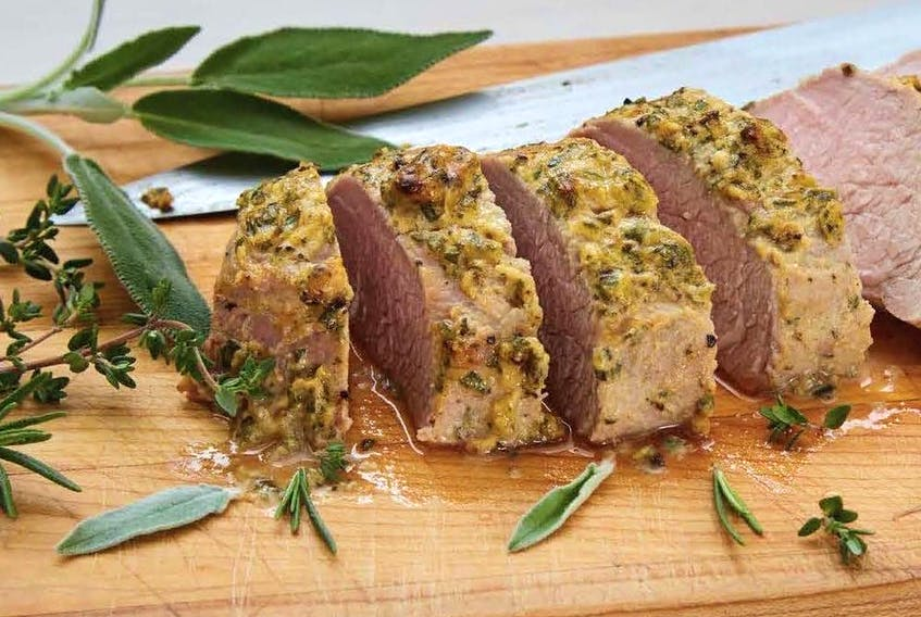 Oven-baked pork tenderloin from Culinary Herbs: Grow. Preserve. Cook! by Ontario herb specialist Yvonne Tremblay.