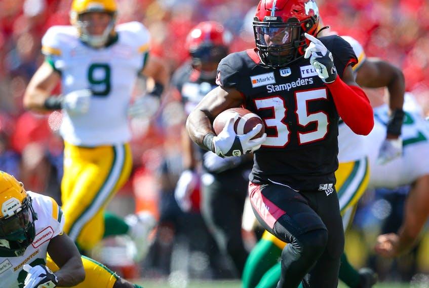 Calgary Stampeders running back Ka'Deem Carey runs for a touchdown against the Edmonton Elks in Calgary on Monday, September 6, 2021.