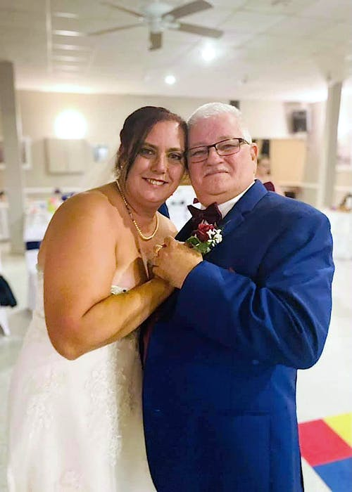 Janice Fletcher in Dominion on her wedding day on July 31 with her father-in-law Jim Fletcher. CONTRIBUTED