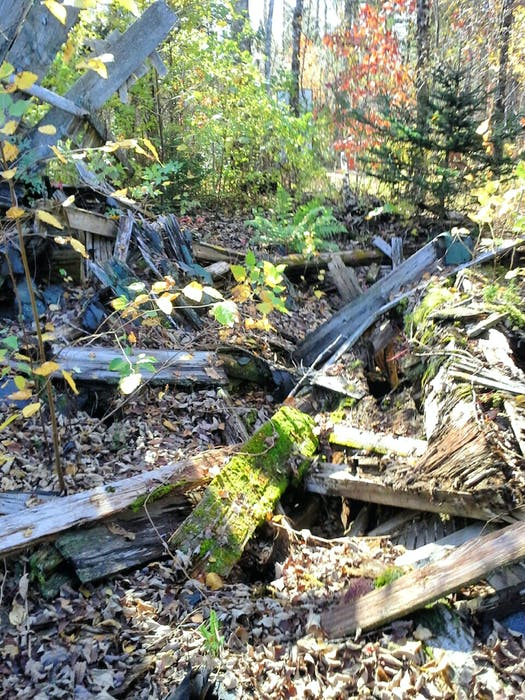 Shreds of lumber remain from the former logging and farming village. - Contributed