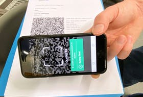 """According to the Quebec government, when the QR code on a fully vaccinated person's phone is scanned, an """"adequately protected"""" message will appear in green."""