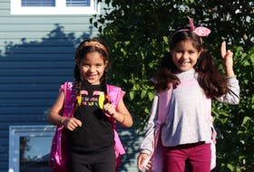 Zayna (left) and Ghrita Guerche on their first day of school on Wednesday morning. The sisters and their mother joined their father, who has been living and working as a chef in Newfoundland and Labrador for a few years, when they moved from Morocco in May 2021. They speak Arabic and French, so will be attending one of the French schools in St. John's, as their parents think this is the best way for them to move forward with their education. However, they've already learned a lot of English over the summer from playing games like hide and seek and tag and swimming with their new friends this summer.