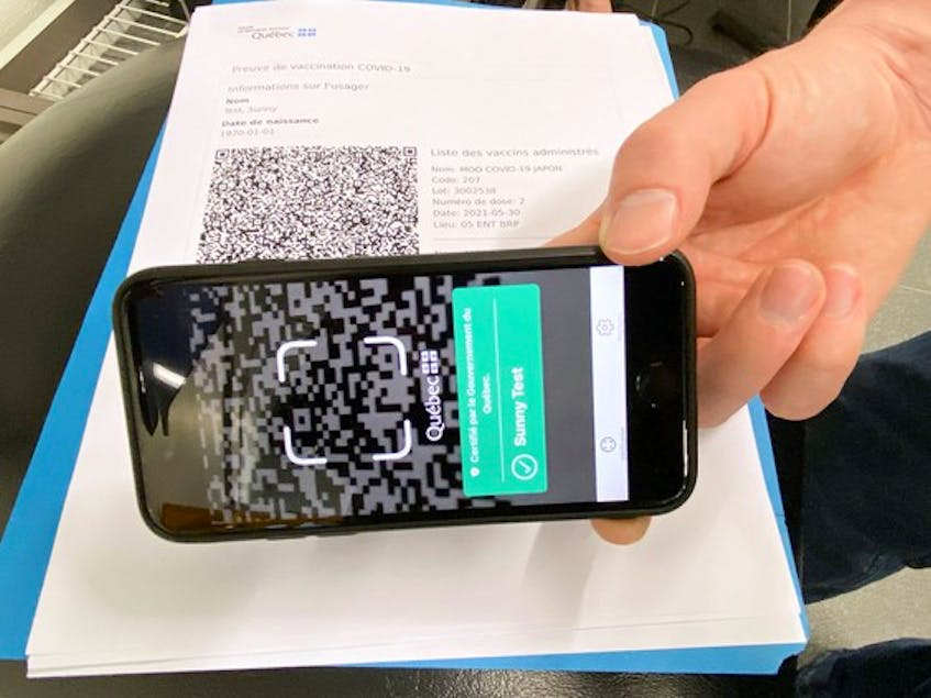 According to the Quebec government, when the QR code on a fully vaccinated person's phone is scanned, an