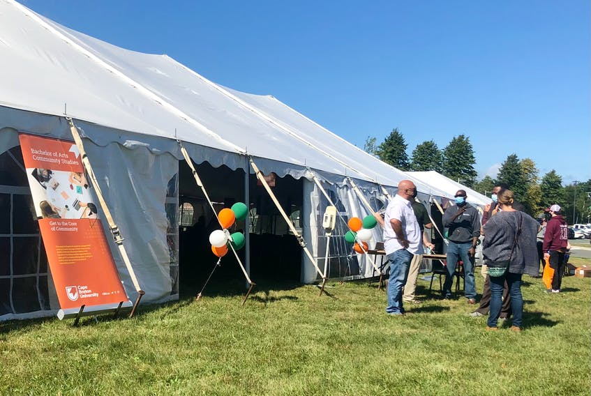 People mingle around one of the tents used for orientation on Tuesday at Cape Breton University. Students' union reps said more students have been participating in orientation events than before the pandemic. NICOLE SULLIVAN/CAPE BRETON POST