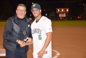 Island Junior 22-Under Baseball League vice-president Blair Creelman, left, presents Gabe Penalver with the most valuable player award for the 2021 playoffs. Penalver helped the Capital District Islanders from Charlottetown defeat the Summerside Toombs and MacDougall CPA Chevys in the league championship series.
