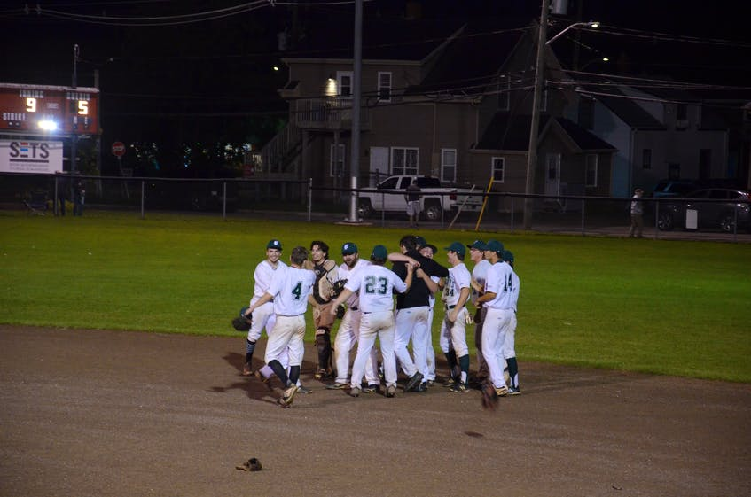 The Capital District Islanders celebrate after winning the Island Junior 22-Under Baseball League championship in Summerside on Sept. 7. The Islanders, who received the Colin (Coke) Grady Memorial Trophy, defeated the host Summerside Toombs and MacDougall CPA Chevys 5-3 in nine innings before a big crowd at Queen Elizabeth Park's Legends Field. - Jason Simmonds