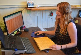 Archivist Ashley Sutherland is leading a project compiling information on businesses in Truro since its incorporation in 1875. Tangible information from directories, like the one on her desk, and other artifacts are being transferred into a database.