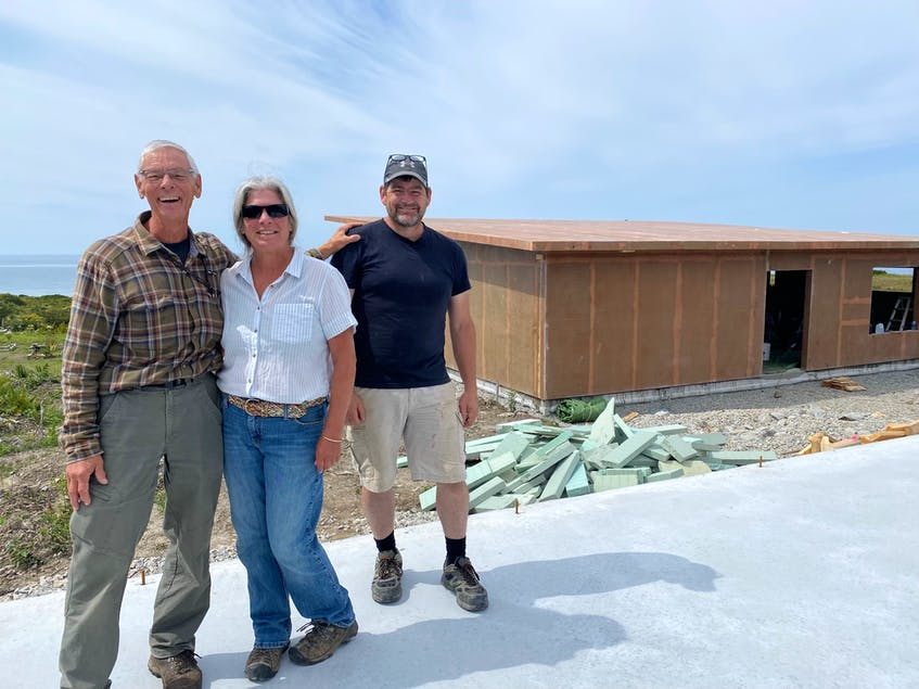 Ray Ligenza and his partner Wendy St. Jean, with JD Composites co-owner David German,  at the rear of their composite home in Sandford. The house is being constructed with recycled PET (polyethylene terephthalate) plastic bottles. CARLA ALLEN • TRI-COUNTY VANGUARD