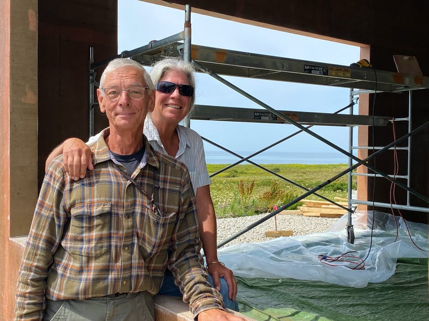 Ray Ligenza and his partner Wendy St. Jean at their composite home in Sandford. The house is being constructed with recycled PET (polyethylene terephthalate) plastic bottles. CARLA ALLEN • TRI-COUNTY VANGUARD
