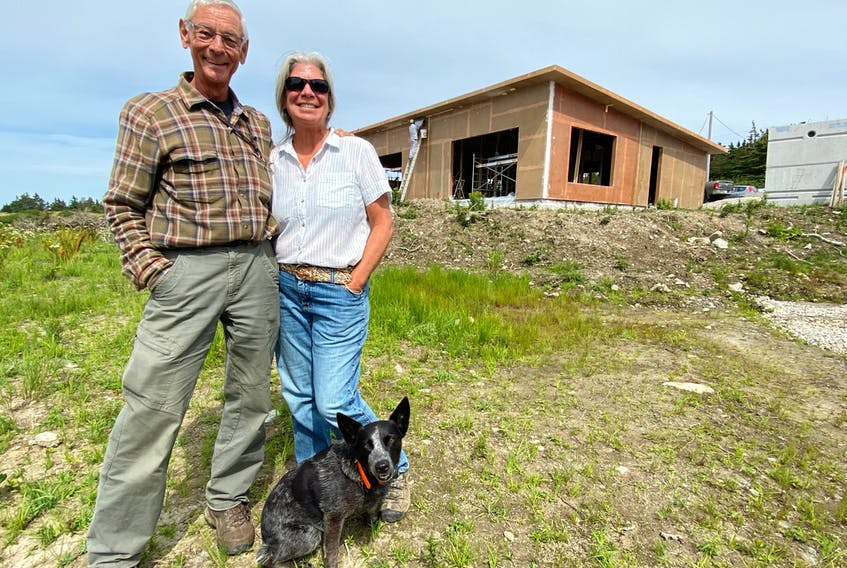 Ray Ligenza and his partner Wendy St. Jean, at the front of their composite home in Sandford, Yarmouth County. The house is being constructed with recycled PET (polyethylene terephthalate) plastic bottles.  CARLA ALLEN • TRI-COUNTY VANGUARD