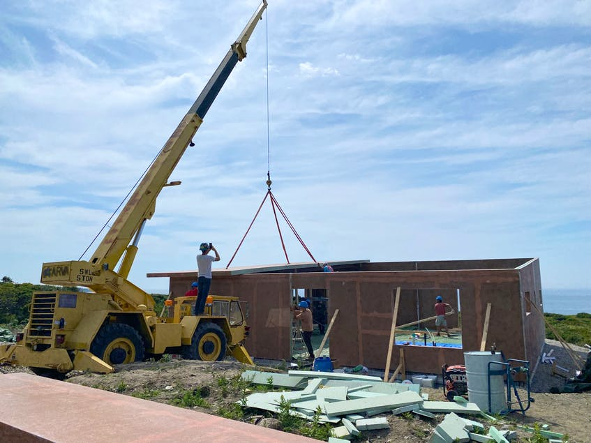 Panels are carefully lifted into place on a new construction in Sandford, the fifth house for JD Composites.CARLA ALLEN • TRI-COUNTY VANGUARD