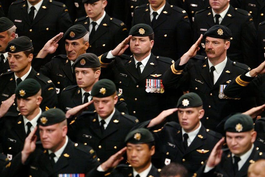 Members of Canada's military pay their respects to Sgt. Robert Short, 42, and Cpl. Robbie Beerenfenger, 29, at a memorial service in Pembroke in the fall of 2003.