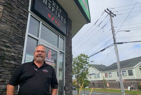 Bill Pratt, owner of the Cheese Curds and Habaneros restaurant chains, outside his Larry Uteck location on Thursday.