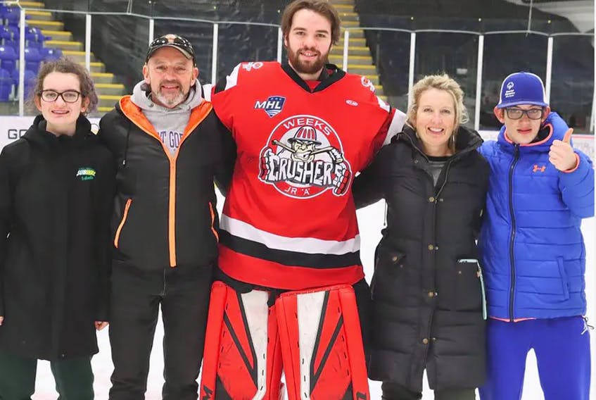 The Tulloch family – Alexis, Kevin, Heather and James – are pictured with Weeks Crushers goalie Lucas Park, who billeted with them last season. JENNIFER WEEKS PHOTO - Contributed