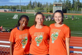 The Cape Breton Capers women's soccer team is looking to make it four consecutive AUS championship titles as they prepare for a return to action following the cancellation of the 2020 season. This year's team captains are shown squinting into the bright sunshine of an early September afternoon training session. From left, defender Fatou Ndiaye, midfielder Amelia Carlini and defender Madison Lavers. DAVID JALA/CAPE BRETON POST