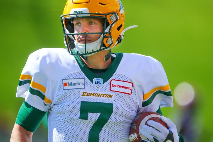 Edmonton Elks quarterback Trevor Harris runs off the field with the football after scoring a touchdown against the Calgary Stampeders in Calgary on Monday, Sept. 6, 2021.