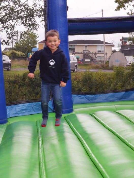 Aiden Fraser, 5, had fun on the bouncy houses from Bounce Around Inflatables that were set up in Westville on Saturday, Sept. 4. - Adam MacInnis