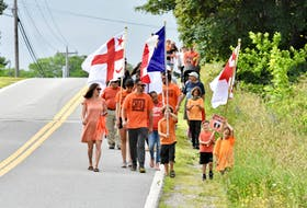 Some families took part in a Canada Day morning family walk to honour the children of residential schools. The walk and accompanying activities was seen as a time for reflection and to spread a message of reconciliation and healing. TINA COMEAU • TRICOUNTY VANGUARD