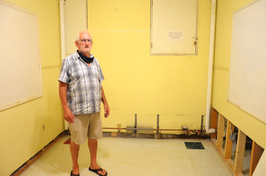 Open Arms core volunteer Bruce Caldwell in one of the educational rooms in the basement of St. Joseph's Catholic Church in Kentville that have served as bedrooms for the Inn From The Cold shelter. The space was devastated by a recent sewage flood. KIRK STARRATT