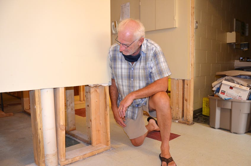 Open Arms core volunteer Bruce Caldwell surveys the damages to Father Jack's Place in the basement of St. Joseph's Catholic Church in Kentville. A recent sewage flood has forced the temporary relocation of the Inn From The Cold shelter, which operates there. KIRK STARRATT