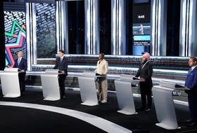 Conservative Party leader Erin O'Toole, Liberal leader Justin Trudeau, Green Party leader Annamie Paul, New Democratic Party leader Jagmeet Singh and leader of the Bloc Quebecois Yves-Francois Blanchet stand at their podiums before the federal election French-language leaders debate, in Gatineau, Quebec, September 8, 2021.