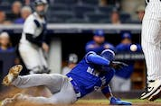 Blue Jays baserunner Lourdes Gurriel Jr. scores on a wild pitch by Yankees pitcher Lucas Luetge during the fourth inning at Yankee Stadium in New York City, Wednesday, Sept. 8, 2021.