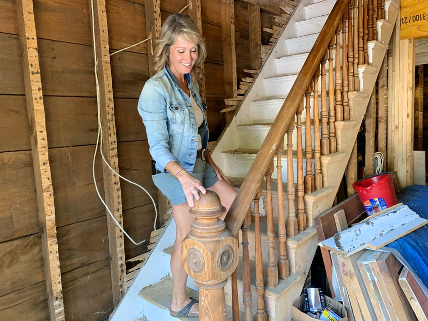 Kimberly Harrison said she likes to wonder how many children have played on this staircase railing throughout the years. - Jen Taplin