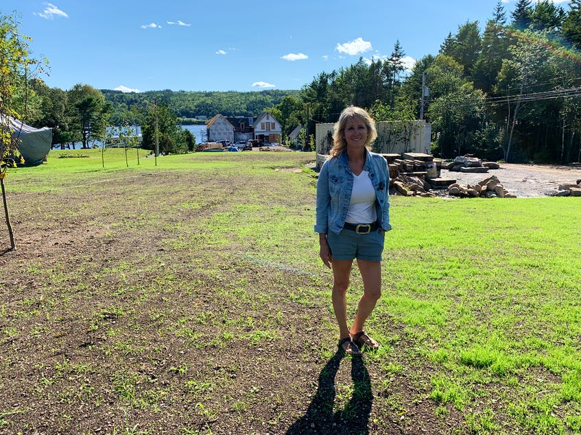 Kimberly Harrison stands where her house used to be before it was moved closer to the LaHave River in June. - Jen Taplin
