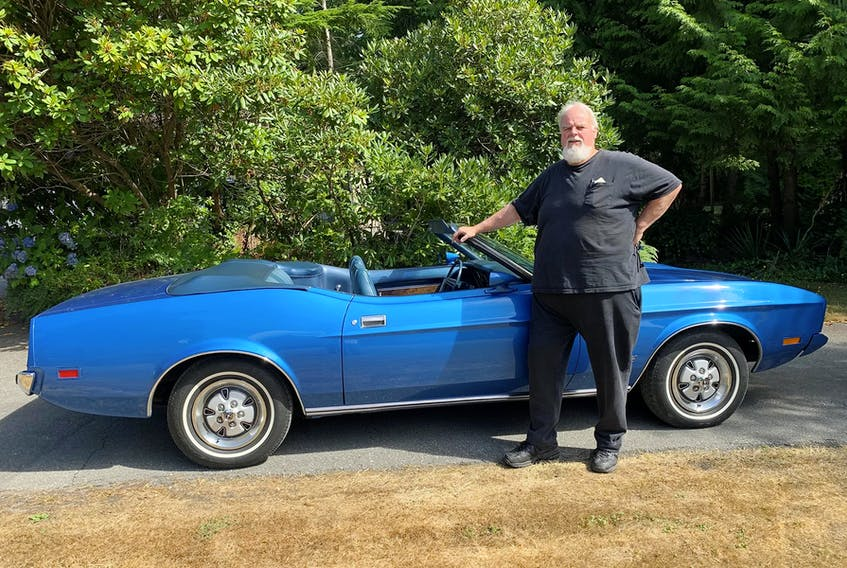 Dave Mitchell with the 1973 Mustang convertible he bought in California to commemorate the Insurance Corporation of British Columbia's 25th anniversary. Alyn Edwards/Postmedia News