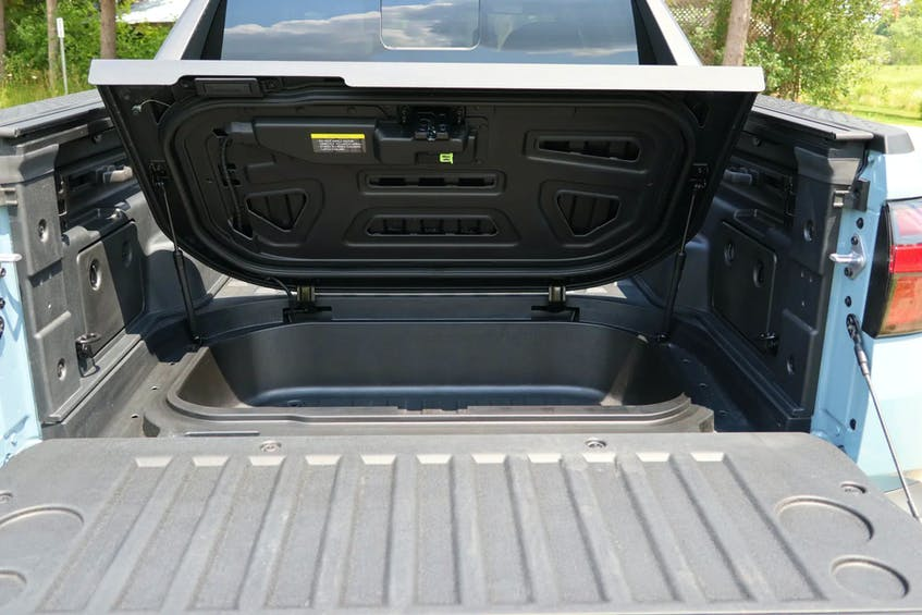 The 2022 Hyundai Santa Cruz has a hidden trunk under the bed floor, with a drain plug for washing out or using as a cooler. Jil McIntosh/Postmedia News - POSTMEDIA