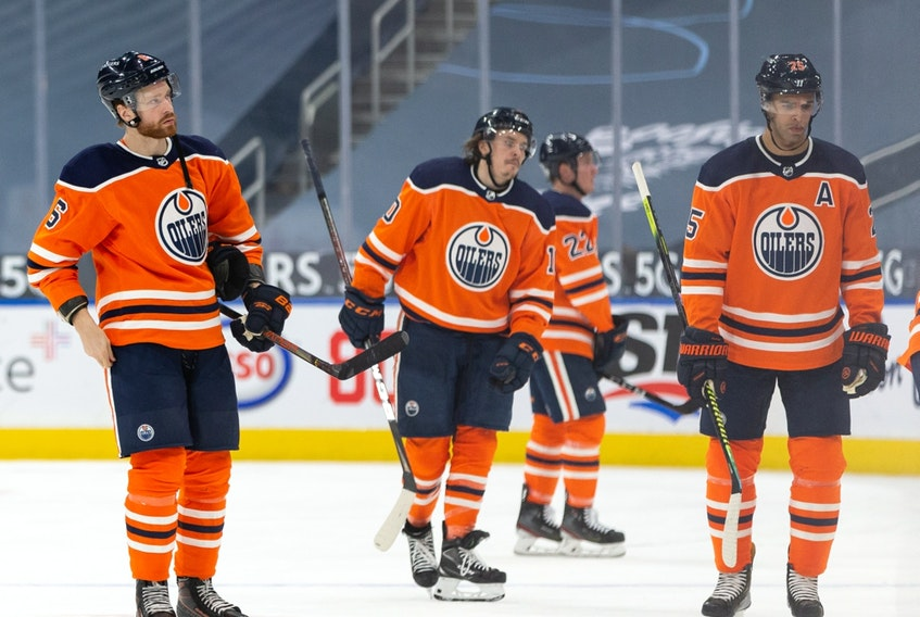 Edmonton Oilers players exit the ice after losing 6-1 to the Toronto Maple Leafs at Rogers Place in Edmonton on Wednesday, March 3, 2021.