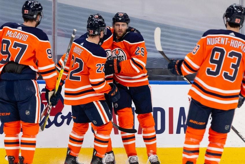 Edmonton Oilers' Leon Draisaitl (29) celebrates a goal with teammates on Ottawa Senators' goaltender Matt Murray (30) during first period NHL action at Rogers Place in Edmonton, on Wednesday, March 10, 2021.