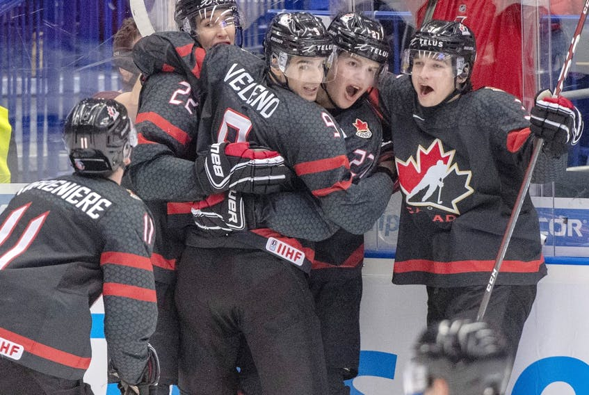 Canada's Dylan Cozens (22, back left) celebrates with teammates (left to right) Alexis Lafreniere, Joe Veleno, Barrett Hayton and Calen Addison after scoring the first goal against Russia in the gold-medal game of the world junior hockey championships on Jan. 5, 2020 in Ostrava, Czech Republic.