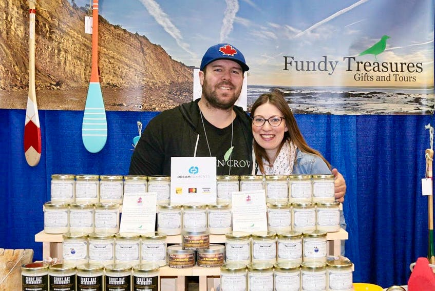 Proud business owners Brian and Laura Hebert at one of their weekly markets. Business is booming for the couple, who are launching the newest aspect of their business: a co-operative retail location.