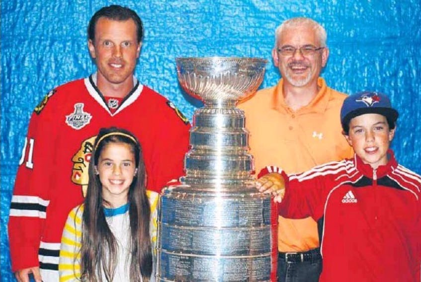 Murray Harbour's Brad Richards hosted a Stanley Cup party for family and friends on July 27, 2015. Members of that family included Guardian reporter Dave Stewart and his children Cassie, left, and Taylor.