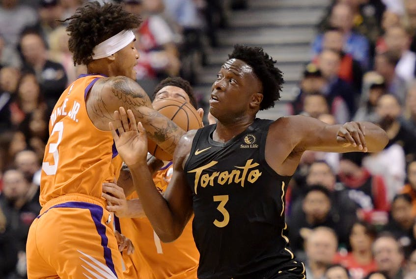 Toronto Raptors forward OG Anunoby knocks the ball loose from Phoenix Suns forward Kelly Oubre Jr. during a game earlier this season.