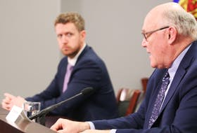 Nova Scotia Premier Iain Rankin looks on as Chief Medical Officer Robert Strang answers questions from the media during a Covid-19 briefing Tuesday.