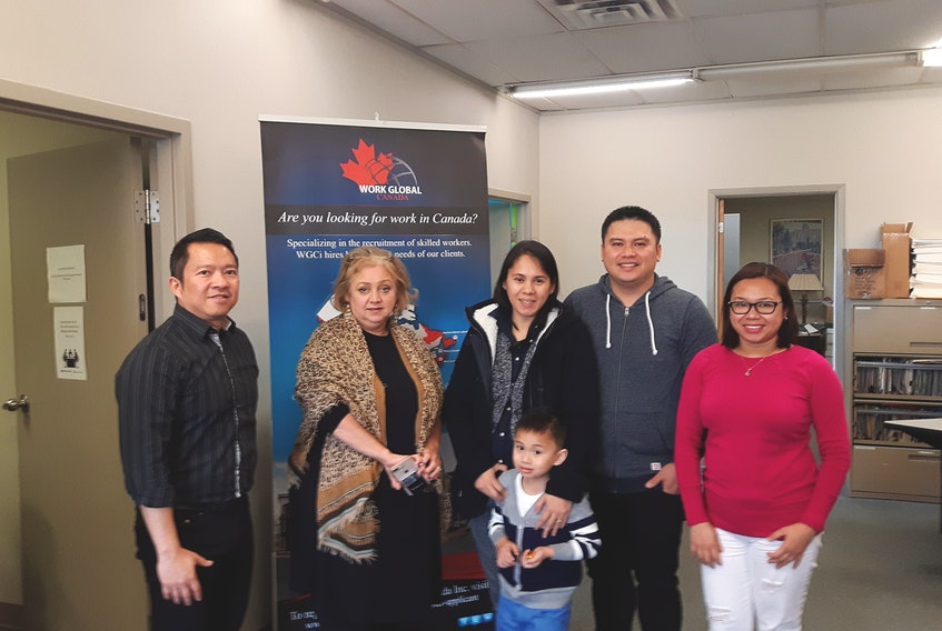 Work Global Canada Inc. is supported by a multicultural staff, with members from France, Philippines, China, Bangladesh, Jordon and India, including Vice President of Operations, Wanda Cuff-Young, second from left.