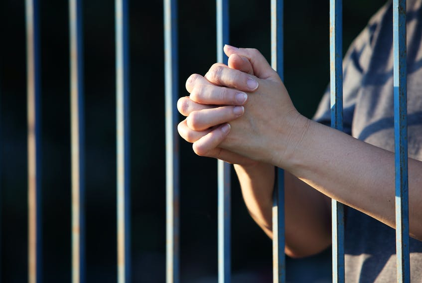 A woman in jail.