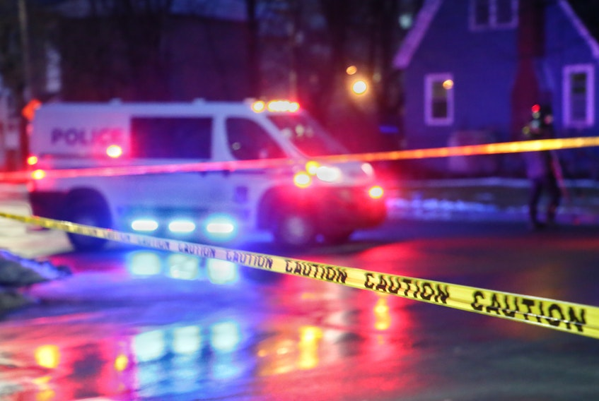 Halifax police block off the scene at the intersection of Connaught and Chisholm avenues early Monday morning after a late-night shooting sent a 32-year-old man to hospital with life-threatening injuries.