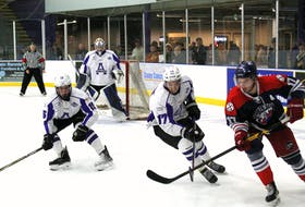 Nick Yuill (left) and Hunter McIntyre of the Amherst CIBC Wood Gundy Ramblers chase down a South Shore Lumberjacks player in recent MHL action at the Amherst Stadium. The Ramblers are in Bridgewater on Friday night and back home Saturday against the Valley Wildcats.