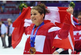 Team Canada's Rebecca Johnston celebrates a gold medal after Canada defeated the U.S. 3-2 in overtime during the Ice Hockey Women's Gold Medal Game at the Sochi 2014 Winter Olympics in this photo from Feb. 20, 2014.