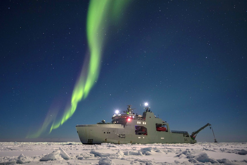 HMCS Harry DeWolf under the Northern Lights.