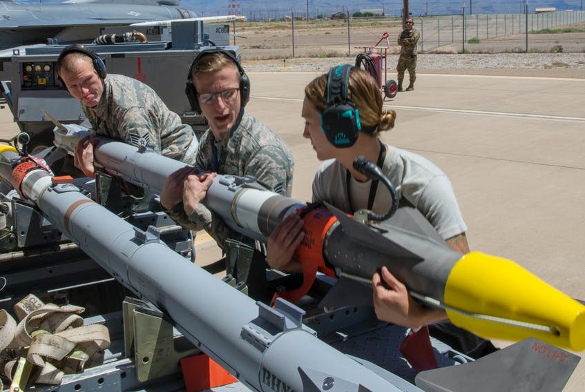 U.S. Air Force personnel prepare the AIM-9X Sidewinder missile for use during a live fire test at Holloman Air Force Base, New Mexico on April 23, 2019. (U.S. Air Force photo)