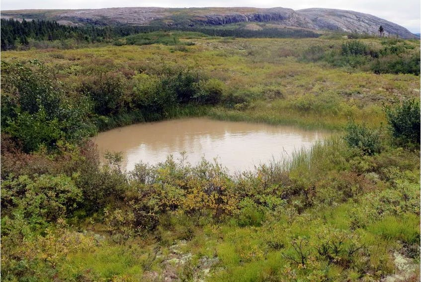 This picture, taken on Sept. 17, 2015, in the Nunavik region, northern Canada, shows a thermokarst water hole. Scientists are studying the impact of the permafrost thawing on climate.