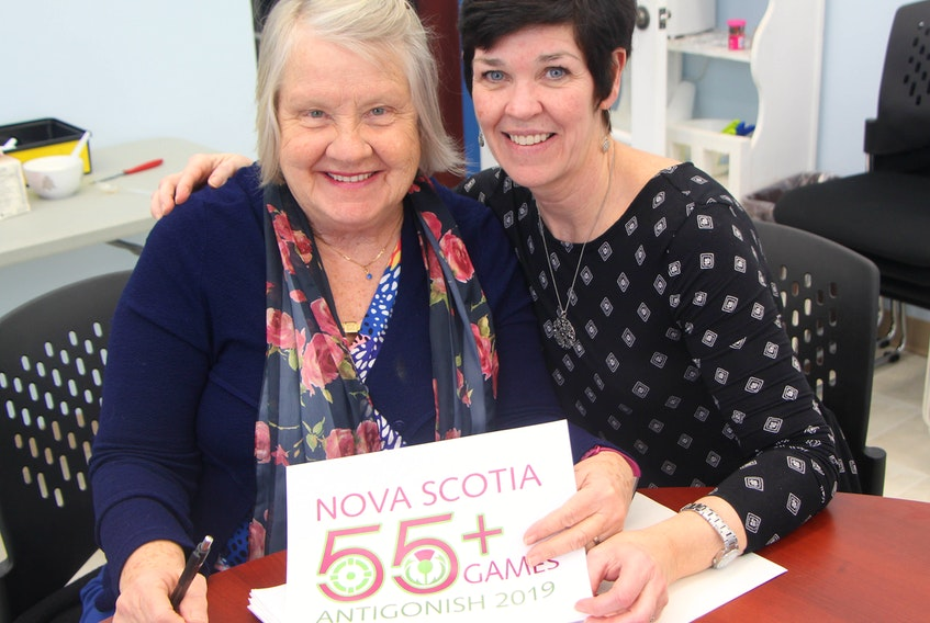 2019 Nova Scotia 55+ Games co-chair, veteran town councillor Diane Roberts, and town director of recreation and special events Tricia Cameron hold a copy of the event's logo which has been recently approved by the provincial board.