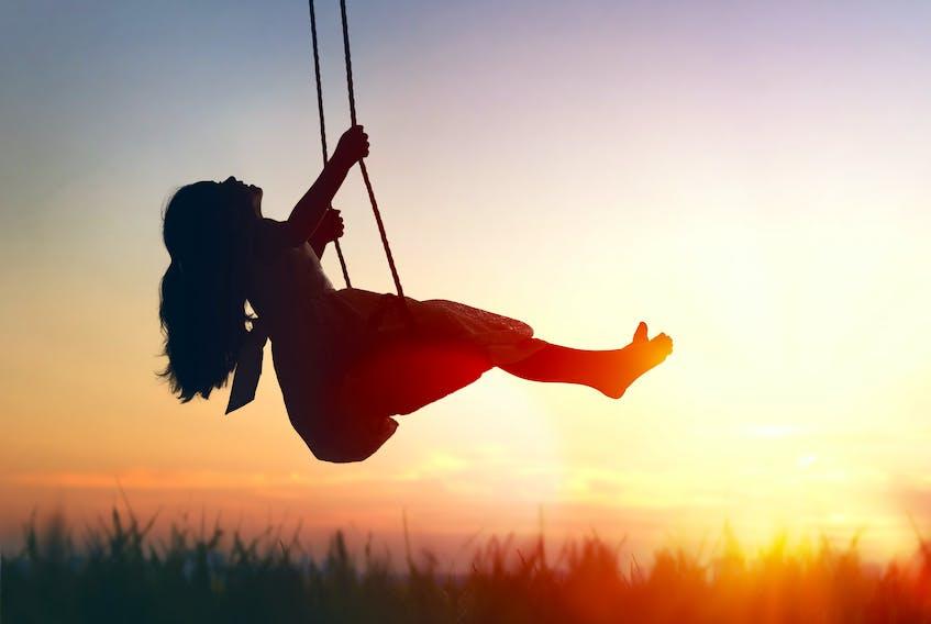 Girl on swing, sunset