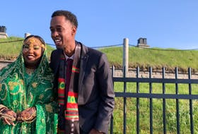 Abawajy dressed in Oromo traditional clothes and Youssouf wearing an Oromo scarf stood at the top of Citadel Hill to greet friends and family who stayed in their cars.