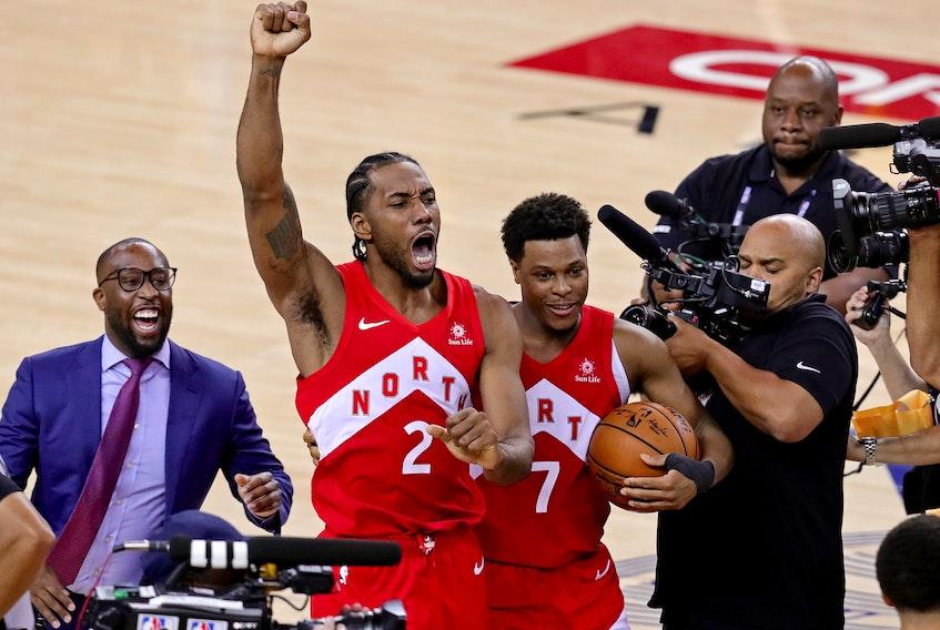 One year ago Toronto Raptors forward Kawhi Leonard (2) and Toronto Raptors guard Kyle Lowry (7) celebrate winning the NBA Championship over the Golden State Warriors.