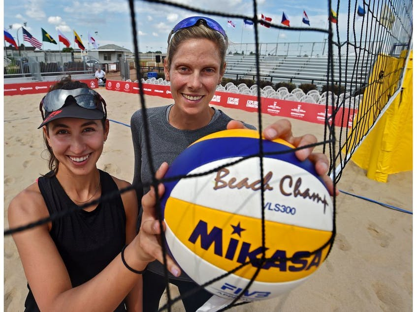 World champs, Canadians Sarah Pavan (R) and Melissa Humana-Paredes at the official kick-off of the FIVB Beach Volleyball World Tour with 90 teams representing 25 countries at the former Northlands Park Race Track in Edmonton, July 16, 2019.  - Ed  Kaiser